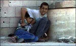 Muhammad Al-Durrah (12) and his father - civilians caught in the way of Israeli snipers.